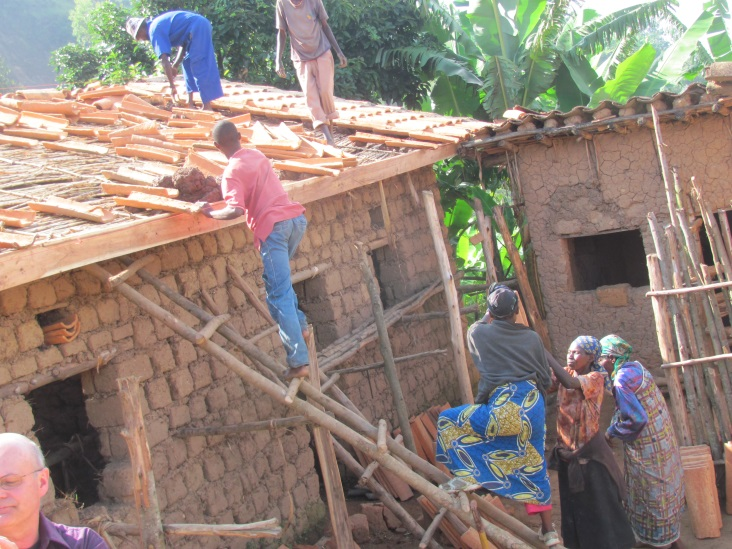 Nyange-Community-Completing-A-House-For-A-Widow